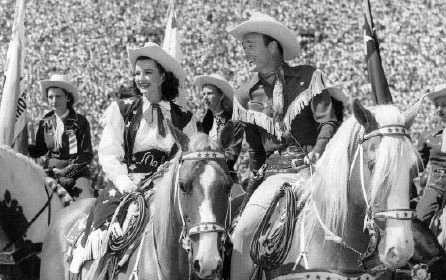 Dale Evans and Roy Rogers before a crowd of over 100,000 at the Sheriff's Rodeo at the L. A. Coliseum in 1949.