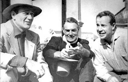 "Classic photo of John Wayne, Randolph Scott and director Budd Boetticher on the set of ""7 Men From Now"" which starred Scott and was produced by Wayne's Batjak Productions."