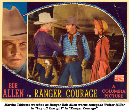 "Martha Tibbetts watches as Ranger Bob Allen warns renegade Walter Miller to ""Lay off that girl"" in ""Ranger Courage""."