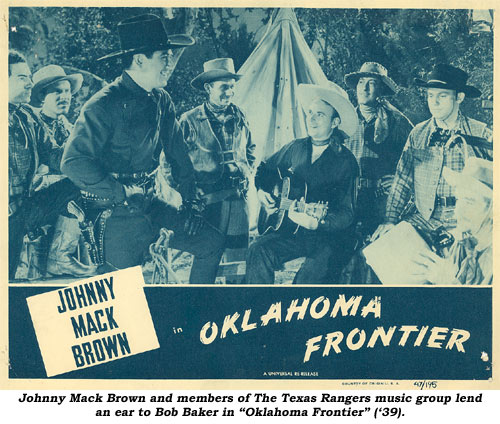 "Johnny Mack Brown and members of The Texas Rangers music group lend an ear to Bob Baker in ""Oklahoma Frontier"" ('39)."