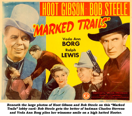 "Beneath the large photos of Hoot Gibson and Bob Steele on this ""Marked Trails"" lobby card: Bob Steele gets the better of badman Charles Stevens and Veda Ann Borg plies her winsome smile on a high hatted Hooter."