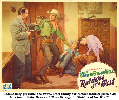 "Charlie King prevents Lee Powell from taking out further frontier justice on henchmen Eddie Dean and Glenn Strange in ""Raiders of the West""."