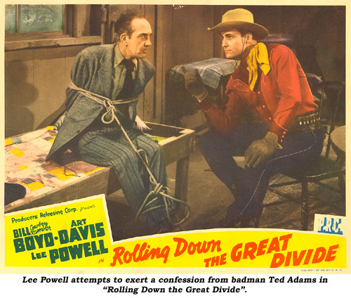 "Lee Powell attempts to exert a confession from badman Ted Adams in ""Rolling Down the Great Divide""."