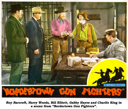"Roy Barcroft, Harry Woods, Bill Elliott, Gabby Hayes and Charlie King in a scene from ""Bordertown Gun Fighters""."