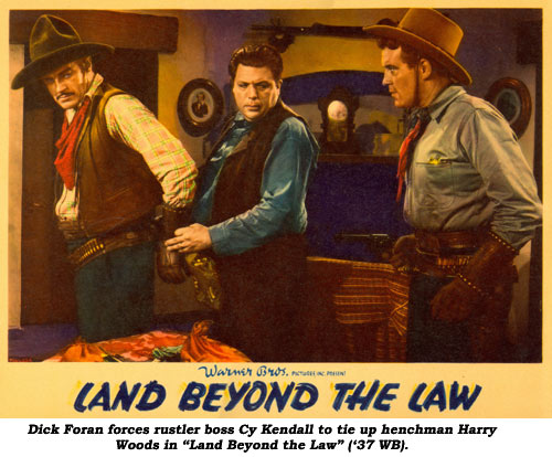 "Dick Foran forces rustler boss Cy Kendall to tie up henchman Harry Woods in ""Land Beyond the Law"" ('37 WB)."