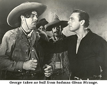 "George takes no bull from badman Glenn Strange in ""Fighting Gringo"" ('39 RKO)."
