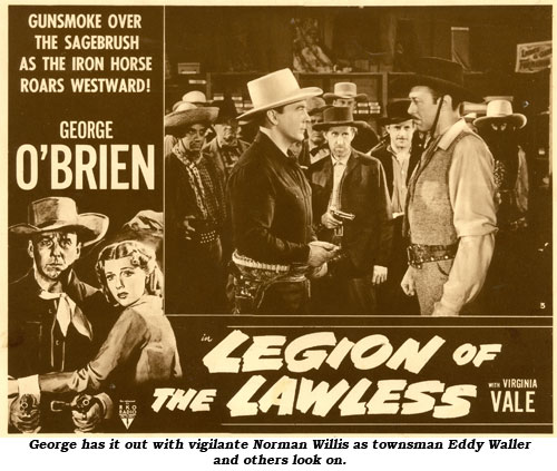 "George has it out with vigilante Norman Willis as townman Eddy Waller and others look on in ""Legion of the Lawless""."