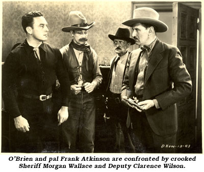 "O'Brien and pal Frank Atkinson are confronted by crooked Sheriff Morgan Wallace and Deputy Clarence Wilson in ""Smoke Lightning""."