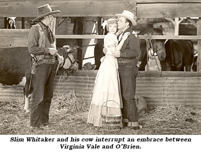 "Slim Whitaker and his cow interrupt an embrace between Virginia Vale and George O'Brien in ""Prairie Law"" ('40 RKO)."