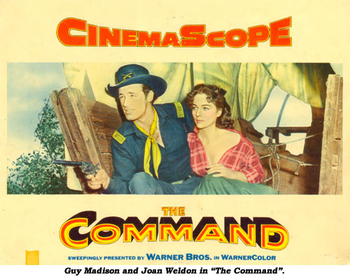 "Guy Madison and Joan Weldon in ""The Command""."