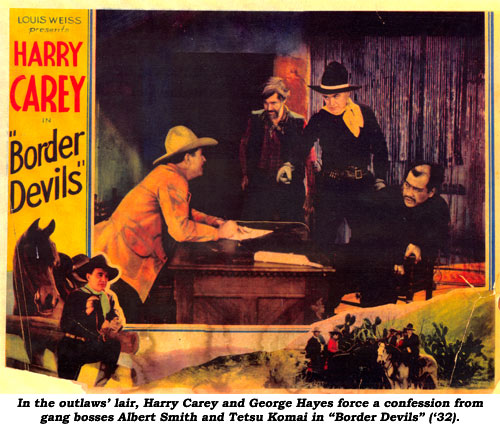 "In the outlaws' lair, Harry Carey and George Hayes force a confession from gang bosses Albert Smith and Tetsu Komai in ""Border Devils"" ('32)."