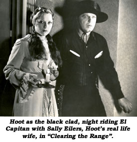 "Hoot as the black clad, night riding El Capitan with Sally Eilers, Hoot's real life wife, in ""Clearing the Range""."
