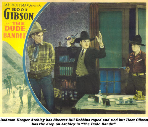 "Badman Hooper Atchley has Skeeter Bill Robbins roped and tied but Hoot Gibson has the drop on Atchley in ""The Dude Bandit""."