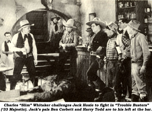 "Charles ""Slim"" Whitaker challenges Jack Hoxie to fight in ""Trouble Busters"" ('33 Majestic). Jack's pals Ben Corbett and Harry Todd are to his left at the bar."