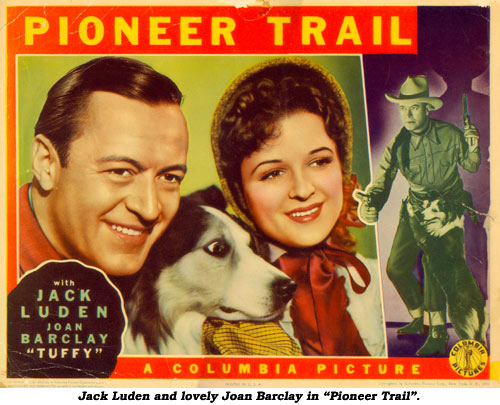 "Jack Luden and lovely Joan Barclay in ""Pioneer Trail""."