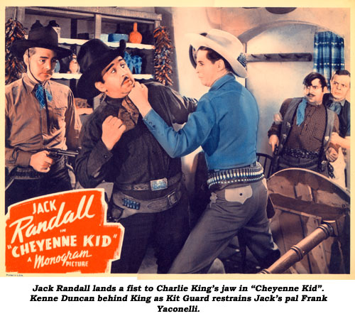 "Jack Randall lands a fist to Charlie King's jaw in ""Cheyenne Kid"". Kenne Duncan behind King as Kit Guard restrains Jack's pal Frank Yaconelli."