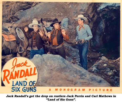 "Jack Randall's got the drop on rustlers Jack Perrin and Carl Mathews in ""Land of Six Guns""."