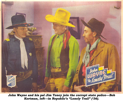 "John Wayne and his pal Jim Toney join the corrupt state police---Bob Kortman, left---in Republic's ""Lonely Trail"" ('36)."
