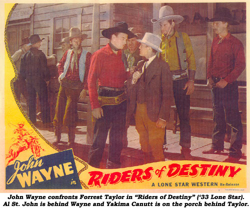 "John Wayne confronts Forrest Taylor in ""Riders of Destiny"" ('33 Lone Star). Al St. John is behind Wayne and Yakima Canutt is on the porch behind Taylor."