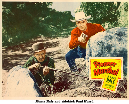 "Monte Hale and sidekick Paul Hurst in ""Pioneer Marshal""."