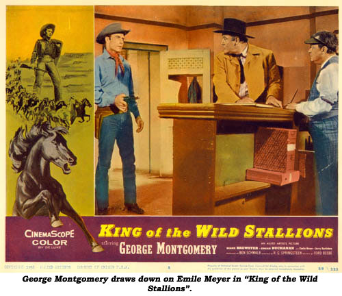 "George Montgomery draws down on Emile Meyer in ""King of the Wild Stallions""."