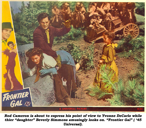 "Rod Cameron is about to express his point of view to Yvonne DeCarlo (by spanking her) while their ""daughter"" Beverly Simmons amusingly looks on. ""Frontier Gal"" ('45 Universal) lobby card."