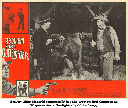 "Brawny Mike Mazurki temporarily has the drop on Rod Cameron in ""Requim for a Gunfighter"" ('65 Embassy)."