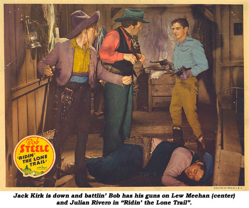 "JackKirk is down and battlin' Bob has his guns of Lew Meehan (center) and Julian Rivero in ""Ridin' the Lone Trail""."