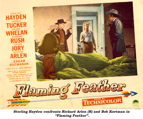 "Sterling Hayden confronts Richard Arlen (R) and Bob Kortman in ""Flaming Feather""."