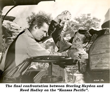 "The final confrontation between Sterling Hayden and Reed Hadley on the ""Kansas Pacific""."