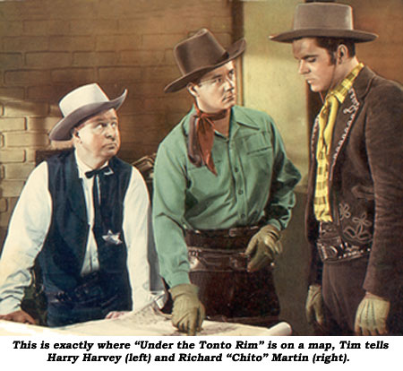 "On a map, Tim lets Harry Harvey (left) and Richard ""Chito"" Martin (right) know exactly where ""Under the Tonto Rim"" is."