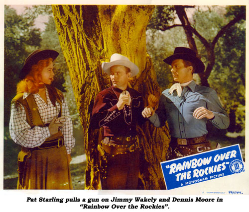 "Pat Starling pulls a gun on Jimmy Wakely and Dennis Moore in ""Rainbow Over the Rockies""."