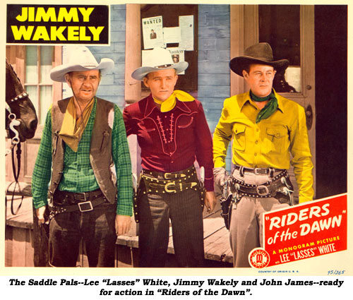 "The Saddle Pals--Lee ""Lasses"" White, Jimmy Wakely and John James--ready for action in ""Riders of the Dawn""."