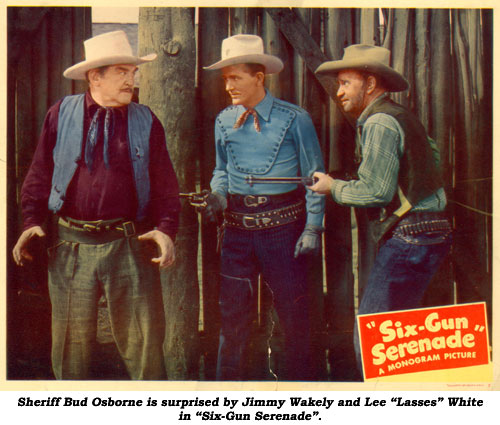 "Sheriff Bud Osborne is surprised by Jimmy Wakely and Lee ""Lasses"" White in ""Six-Gun Serenade""."